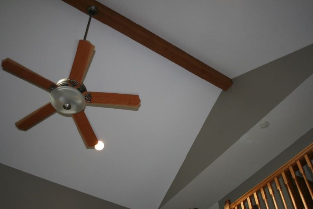 The beam's hollow design allowed for an easy installation of the ceiling fan.