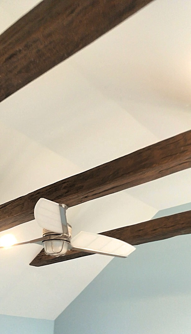 Hanging a ceiling fan from a suspended beam was easy due to the beam's hollow center.