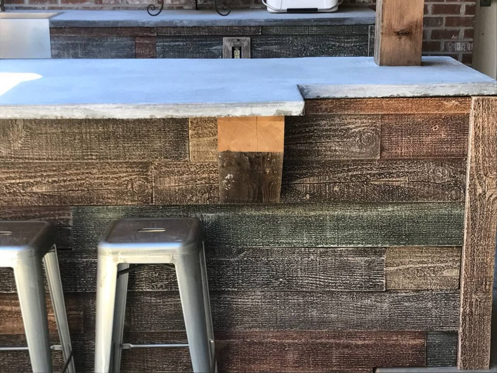 The concrete countertop and real wood supports pair perfectly to provide a rugged, outdoorsy look.
