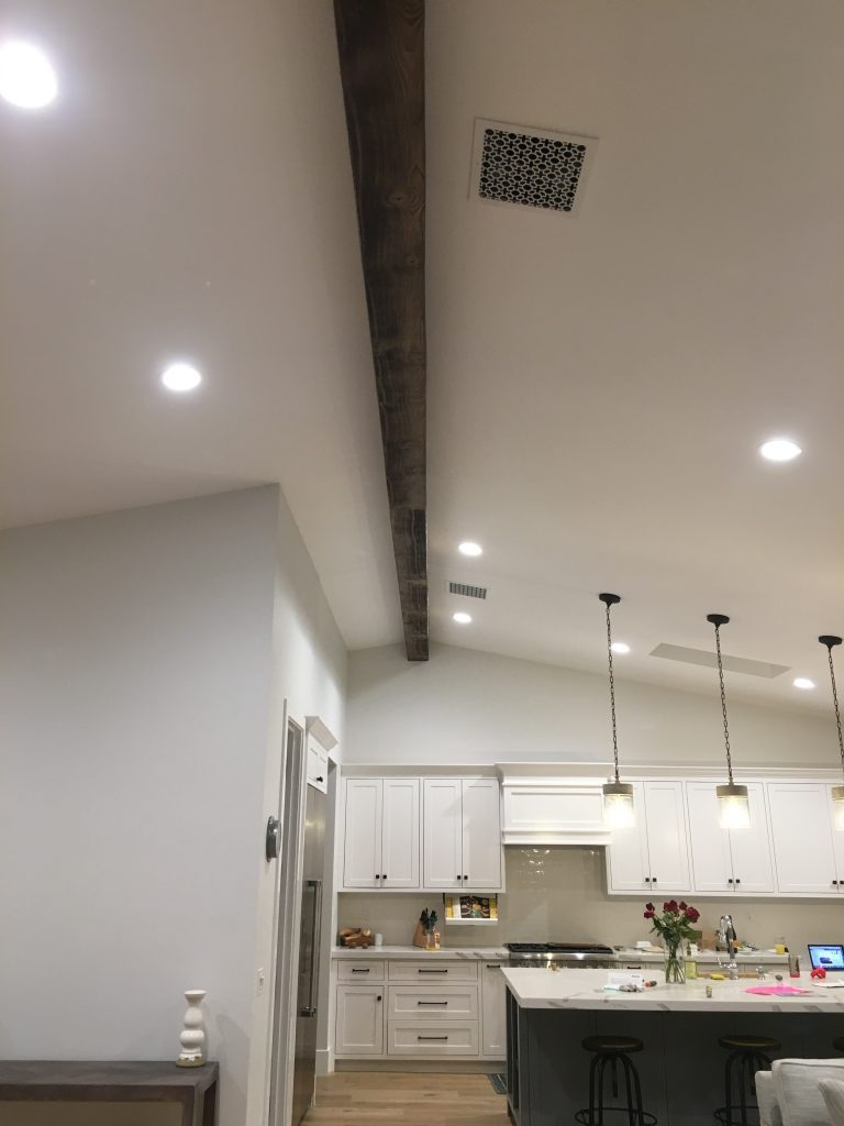 This large beam installed on a kitchen ceiling is actually two lengths of faux beams joined to span its over 30 foot length.