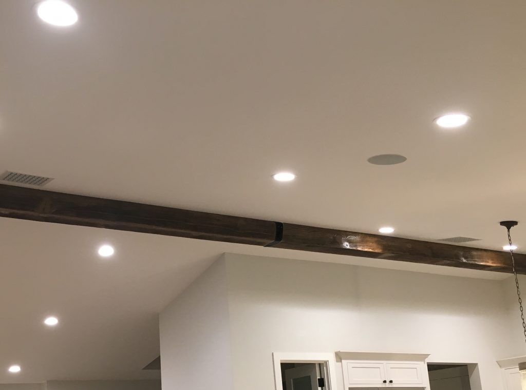 The subtle application of a beam strap helps hide the seam, and create the impression of a single length of solid timber.