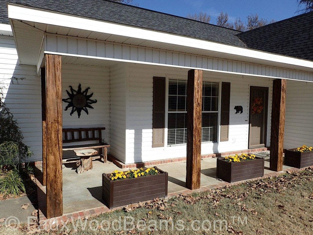 An Arkansas' home porch posts wrapped in imitation timber